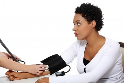 Woman checking her blood pressure. https://www.info-on-high-blood-pressure.com/cardiovascular-disease.html