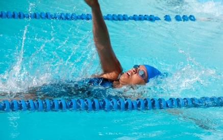 Woman swimming in pool.  https://www.info-on-high-blood-pressure.com/exercisestolowerbloodpressure.html